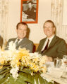 Paul Miller seated with President Richard M. Nixon at the